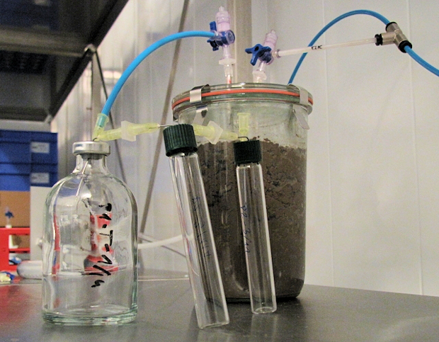 Soil incubation system in the laboratory with sampling vials for emitted soil gases.